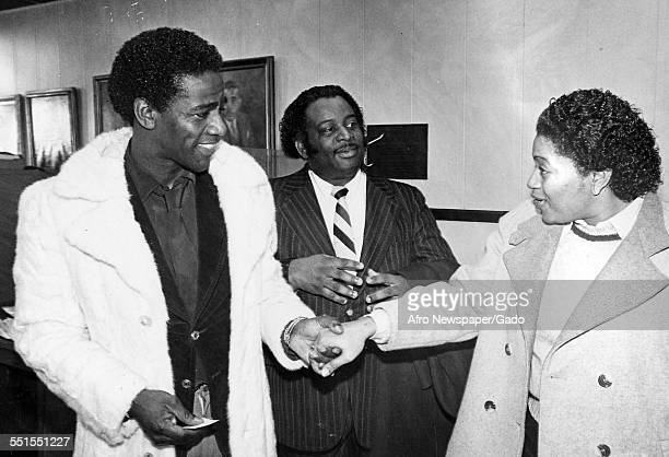 The singer Al Green, shaking hands and greeting a woman and another man, 1981.
