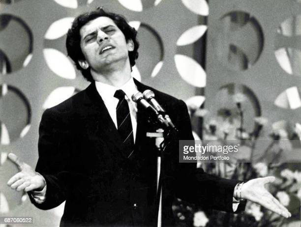 The singer and songwriter Luigi Tenco performs Ciao amore ciao on the stage of Sanremo Music Festival, in his last performance, as his dead body will...