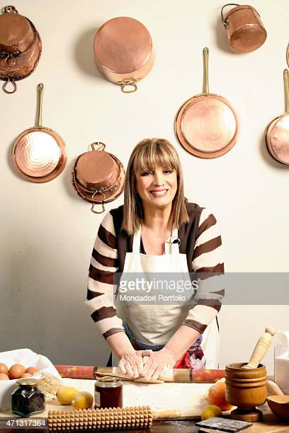 The singer and TV presenter Iva Zanicchi posing for a photo shooting in the kitchen at home Lesmo Italy 7th February 2006