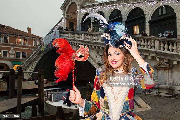The singer Anna Tatangelo sponsor of the Carnival of Venice posing in front of Rialto Bridge wearing a eighteenthcentury courtesan costume inspired...