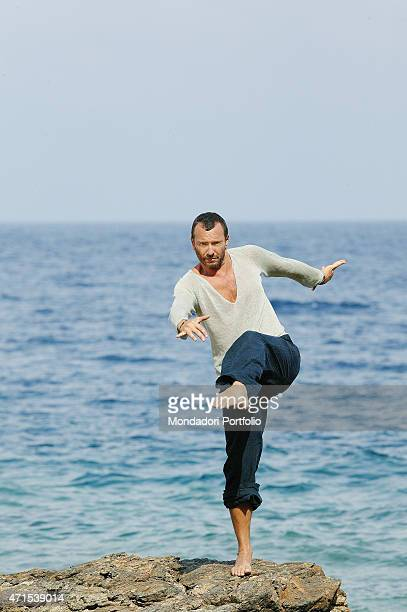 The singer Biagio Antonacci on a rock by the sea in a photo shooting shooted in his house at Isle of Elba Porto Azzurro Italy 11th July 2007