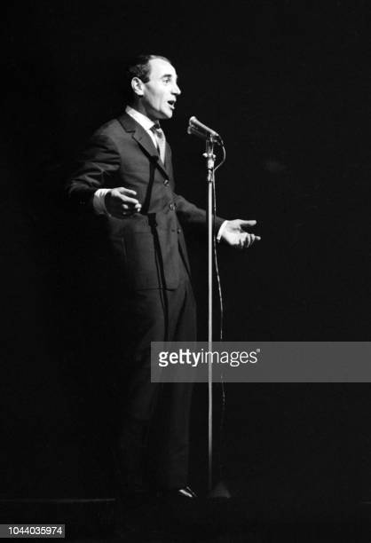 The singer Charles Aznavour performs in Paris on the stage of the Alhambra where he made a triumphant comeback on December 13 1960