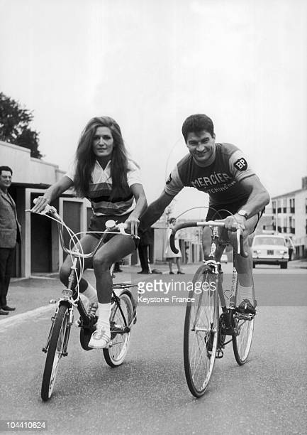 The singer DALIDA tries out her cycling skills alongside top racing cyclist Raymond POULIDOR for the television sports program SI CA VOUS CHANTE...