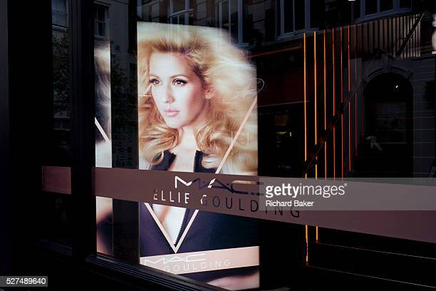The singer, Ellie Goulding's face seen in the window of her own cosmetic brand Mac Cosmetics, in London's Carnaby Street. The pop singer has her name...