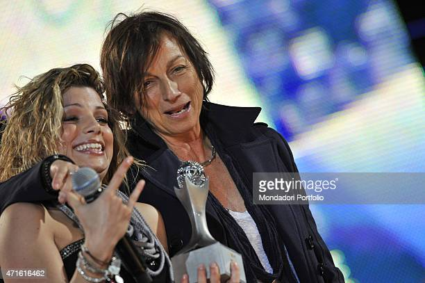 'The singer Emma and Italian singersongwriter Gianna Nannini in a photo shooting at Verona Arena for the Wind Music Awards Emma showing the CD...
