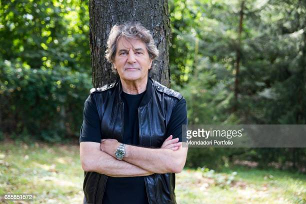The singer Fausto Leali leaning against a tree trunk Milan Italy 28th July 2016