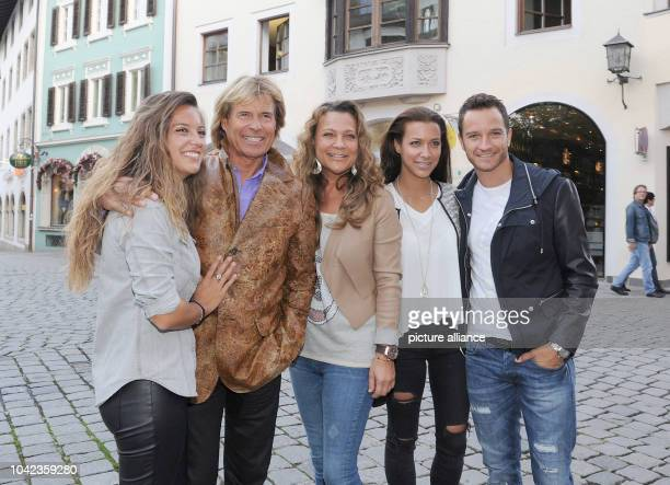 The singer Hansi Hinterseer , his daughter Laura , his wife Romana , his daughter Jessica and her boyfriend Timo Scheider pose in front of the...