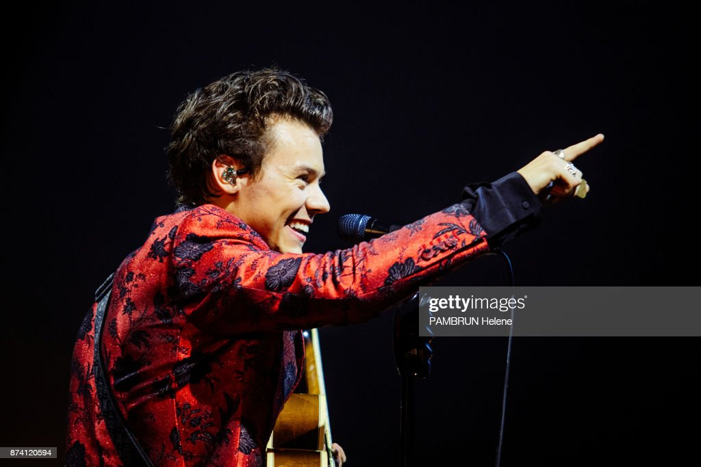 the singer harry styles on stage during his concert at the olympia