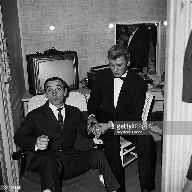The Singer Johnny Hallyday Taking The Pulse Of Charles Aznavour To Measure The Fever Spawned By Success In The Dressing Room At The Olympia On...
