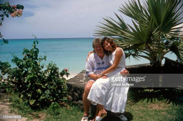 The singer Klaus Baumgart poses on vacation probably on the Bahamas at the beach with his wife Ilona SchulzBaumgart about 1970s