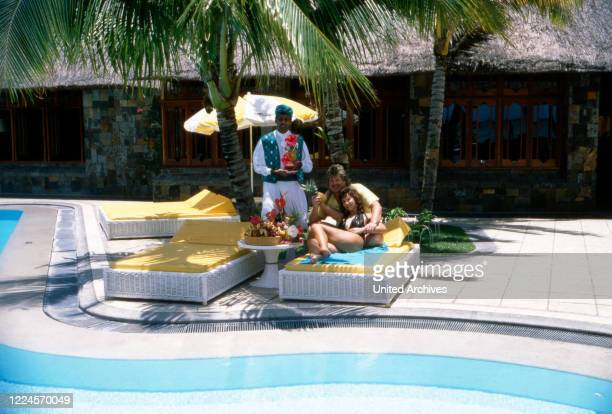 The singer Klaus Baumgart probably poses on holiday in the Bahamas hotel pool with his wife Ilona SchulzBaumgart while they enjoy cocktails and fresh...