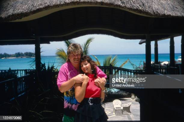 The singer Klaus Baumgart probably poses on holiday in the Bahamas outside the hotel with his wife Ilona SchulzBaumgart circa 1970s