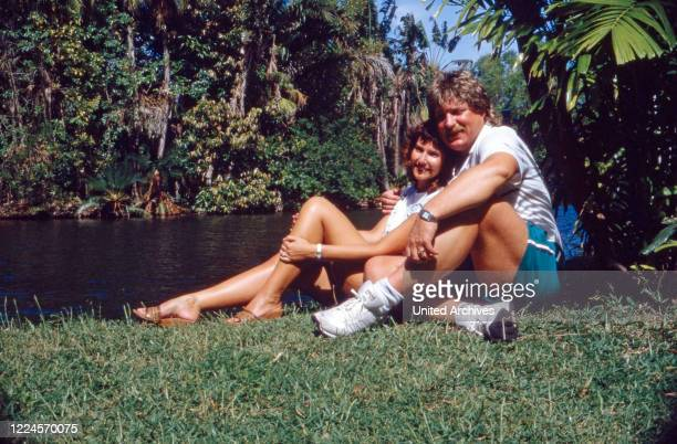 The singer Klaus Baumgart probably poses on holiday in the Bahamas under palm trees with his wife Ilona SchulzBaumgart circa 1970s
