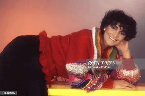 The singer Mia Martini leaning and smiling 1982