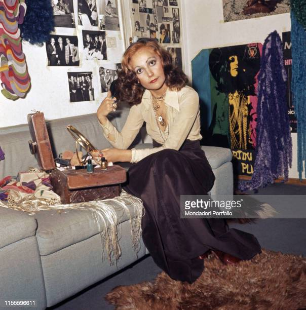 The singer Mia Martini making up herself 1974