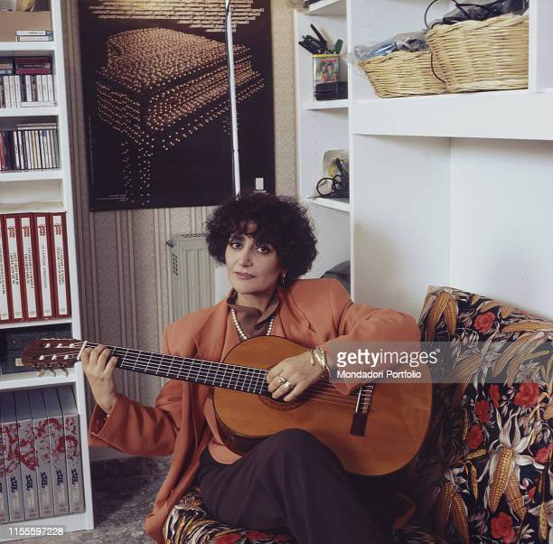 The singer Mia Martini playing the guitar at home Italy 1990