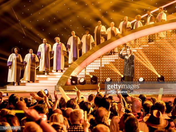 The singer Nana Mouskouri with the 'The Golden Voices of Gospel' during the TV Show 'Hit Champions Great party of the best' at the Velodrom in Berlin...