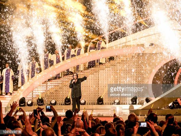 The singer Nana Mouskouri with the The Golden Voices of Gospel during the TV Show Hit Champions Great party of the best at the Velodrom in Berlin...