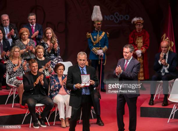 The singer of 'Hombres G', David Summer, receives a the medal of Seville in representation of his father, during the act of delivery of the titles of...