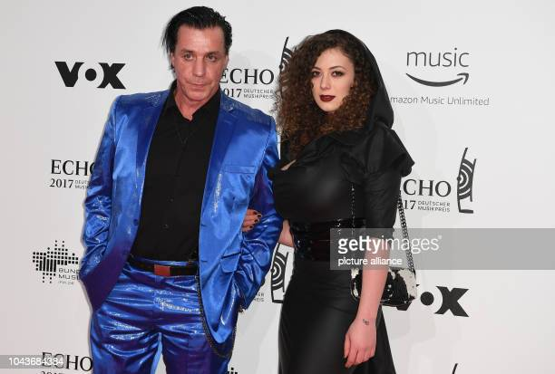 The singer of the band Rammstein Till Lindemann and partner Leila Lowfire arrive at the award ceremony of the 26th German music award 'Echo' in...
