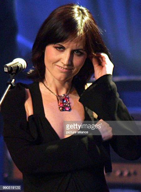 ARCHIVE The singer of the Irish rock group 'The Cranberries' Dolores O'Riordan stands on stage in Bremen 27 November 2004 O'Riordan passed away at...