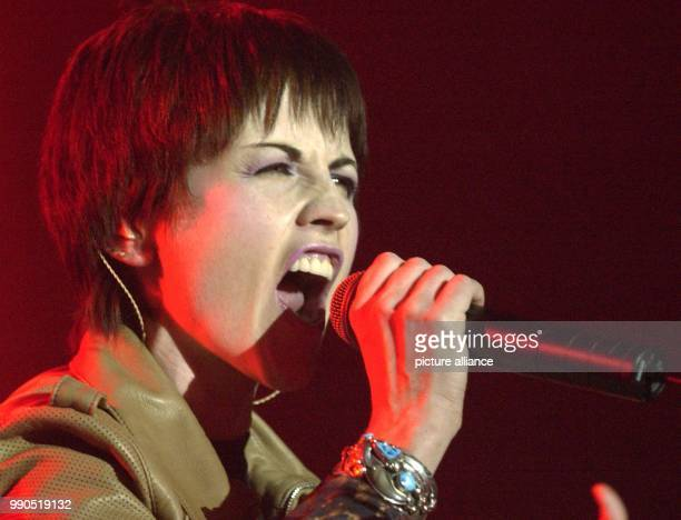 ARCHIVE The singer of the Irish rock group 'The Cranberries' Dolores O'Riordan stands on stage singing 'Zombie' as the start of their 'Wake up and...