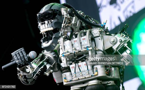 """The 'singer' of the robots' band """"Compressorhead"""" stands on the stage during the Cebit technology fair in Hanover, Germany on June 12, 2018. - The..."""