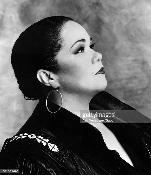 The singer songwriter Etta James in profile looking up 1960