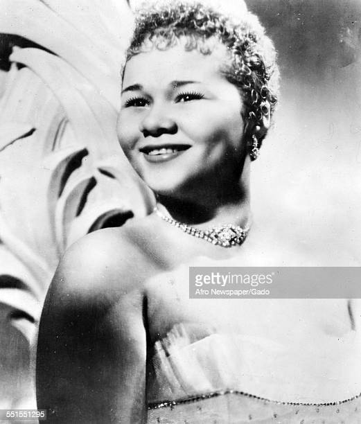 The singer songwriter Etta James on stage smiling 1960