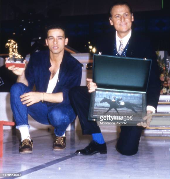The singers Eros Ramazzotti winner with the song Adesso tu and Renzo Arbore second place with Il Clarinetto with the prizes won 36th Sanremo Festival...