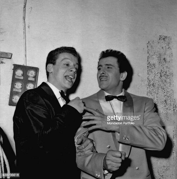 The singers Johnny Dorelli and Domenico Modugno pretending to singing happy after they won the 8th Sanremo Music Festival with the song Nel blu...