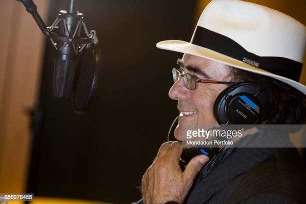 The singersongwriter and actor Al Bano singing over the microphone Milan Italy 5th April 2016
