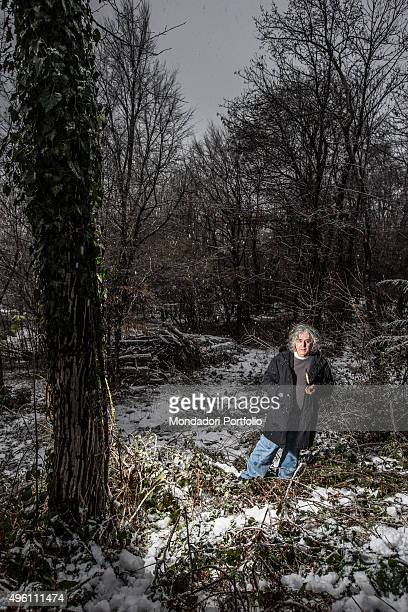The singersongwriter Angelo Branduardi walking in a wood Bedero Valcuvia Italy 14th February 2014