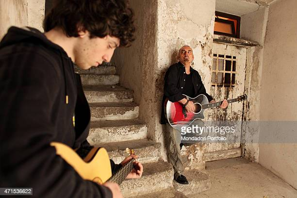 The singersongwriter Mango Giuseppe Mango's stage name with his son Filippo during a photo shoot inside their house they will play together in the...