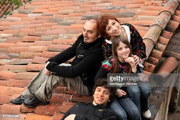 The singersongwriter Mango Giuseppe Mango's stage name with his wife the singer Laura Valente and their children Filippo and Angelina on the roof of...