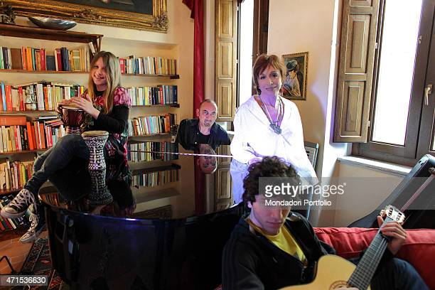 The singersongwriter Mango Giuseppe Mango's stage name with his wife the singer Laura Valente and their children Filippo and Angelina during a photo...