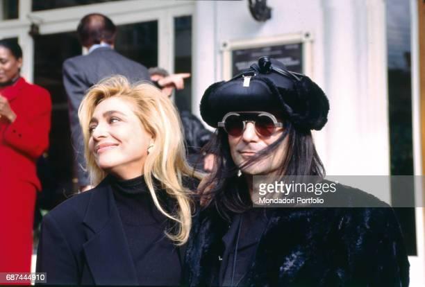 The singersongwriter Renato Zero and the TV presenter Mara Venier at the press conference for the 1994 Sanremo Music Festival Sanremo Italy 1994