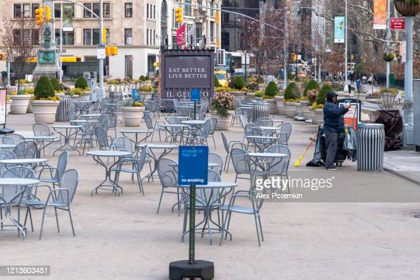 the single sanitation worker cleaning flatiron public plaza deserted during the coronavirus outbreak. - alex potemkin coronavirus stock pictures, royalty-free photos & images