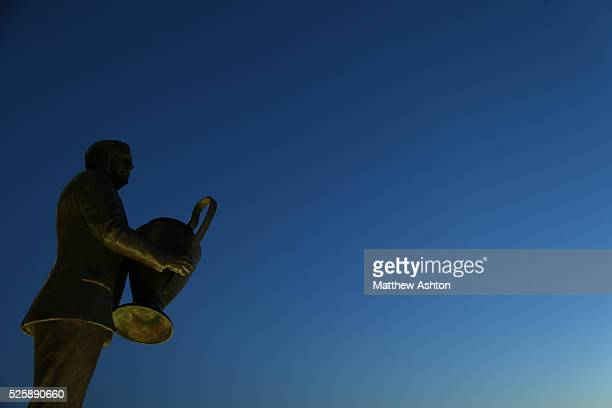The Sir Jock Stein statue at Park Head home of Celtic holding the UEFA European Trophy