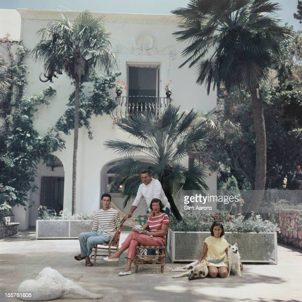 The Sirignano family pose at their residence on the island of Capri Italy 1958 The young girl to the right of the image sits with two dogs while a...
