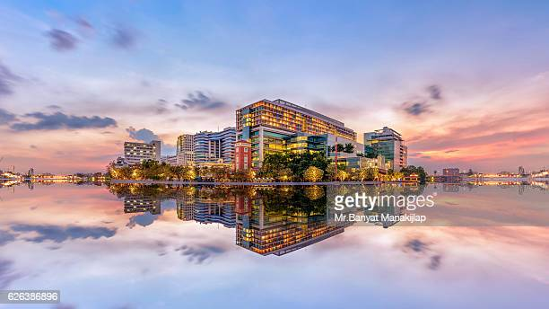 the siriraj hospital in bangkok at sunset - hospital building stock photos and pictures
