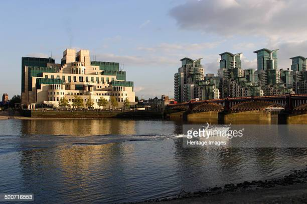 The SIS Building from across the River Thames London Designed by architect Terry Farrell this building has been the headquarters of MI6 since its...