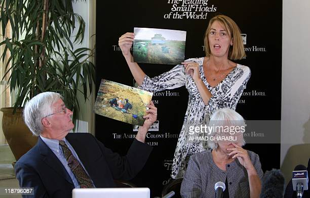 The sister and father of US peace activist Rachel Corrie who was run over by an Israeli bulldozer during a demonstration in Gaza in 2003 display...