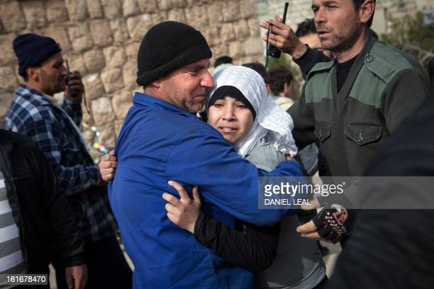 The sister of 5-year old Elaf Daeef and 2-year old Abdo Alhade Daeef, cries outside a hospital in Kafranbel after hearing confirmation that her...