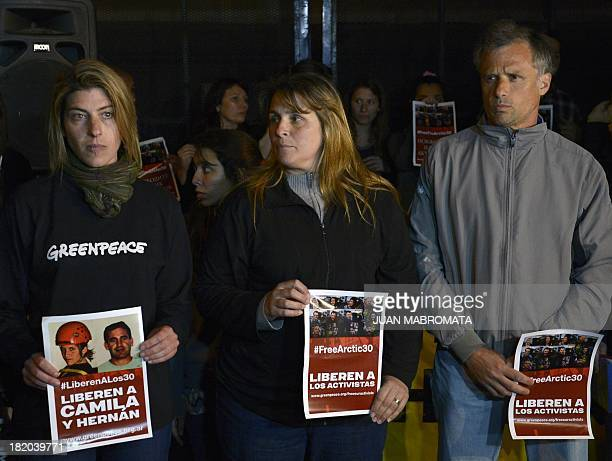The sister of Greenpeace activist Hernan and the parents of Camila attend a protest on September 27 2013 in front of the Russian embassy in Buenos...