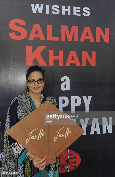 The sister of Indian Bollywood actor Salman Khan Alvira poses for a photograph while holding a kite bearing the name of forthcoming Bollywood film...