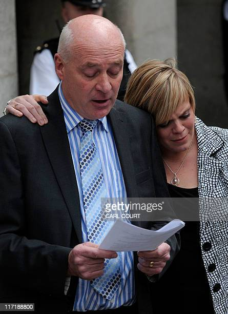 The sister of murdered schoolgirl Amanda Dowler Gemma hugs her father Bob Dowler as he reads a statement outside the Old Bailey in central London on...