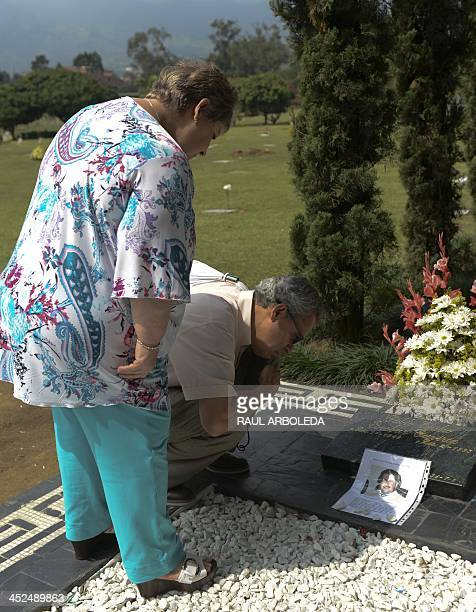 The sister of the Colombian drug lord Pablo Escobar, Luz Maria Escobar and her housband Leonardo Arteaga, visit Escobar's tomb on November 29, 2013...