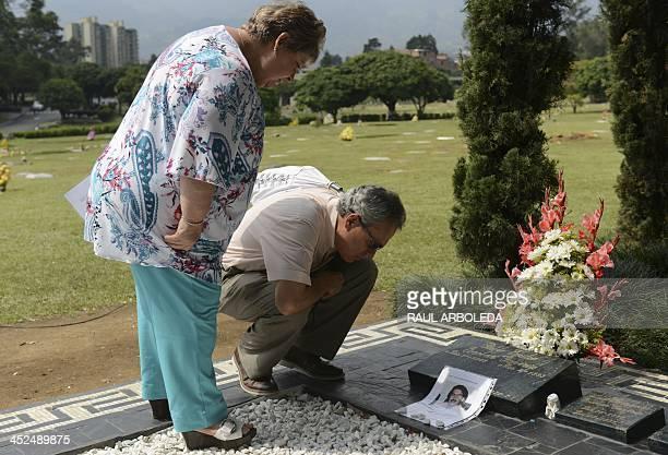The sister of the Colombian drug lord Pablo Escobar Luz Maria Escobar and her housband Leonardo Arteaga visit Escobar's tomb on November 29 2013 at...