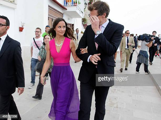 The sister of the Duchess of Cambridge Pippa Middleton leaves on September 19 2014 with an unidentified guest the wedding ceremony of her friends...